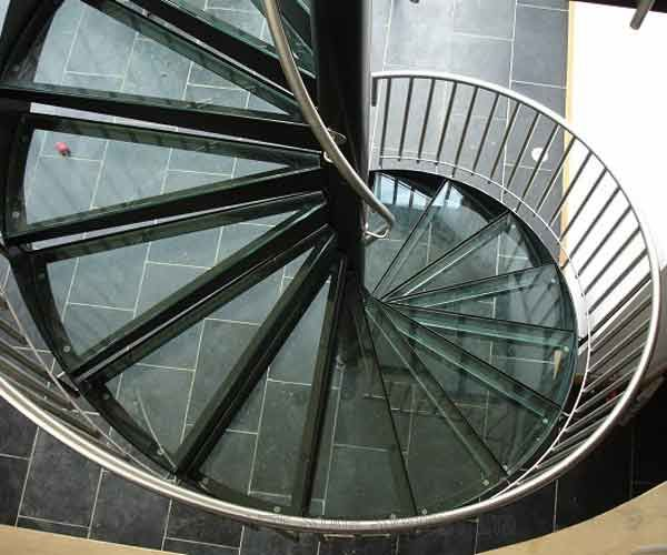 You can see more of this staircase here: http://www.completestairsystems.co.uk/spiral-staircases/glass-tread-spiral-staircase/bespoke-spiral-staircase-essex/