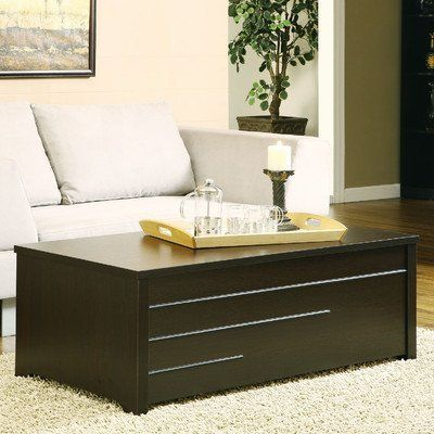 """Benita Storage Trunk Style Coffee Table by Hokku Designs. $240.44. IDI-11418CT Features: -Medium fiber board, veneered frame.-Slide-top compartment reveals two storage spaces to bring your room together in an orderly fashion.-Intriguing lines on front of the coffee table gives the coffee table an uplifting appearance. Color/Finish: -Dark Espresso finish. Dimensions: -Storage Dimensions: 11"""" H x 20"""" W x 22"""" D. Collection: -Benita collection. Warranty: -30 Day manufacturer limited ..."""