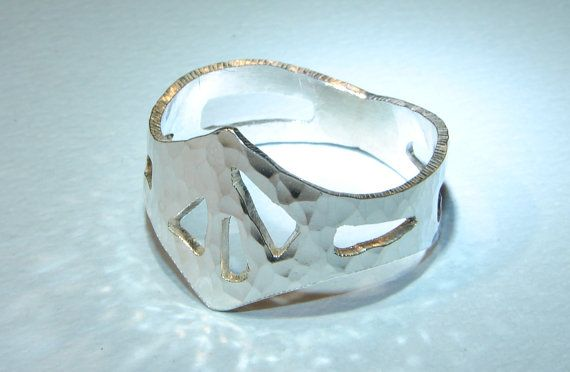 Hammered sterling silver king ring with cut outs and by NiciLaskin, $60.00