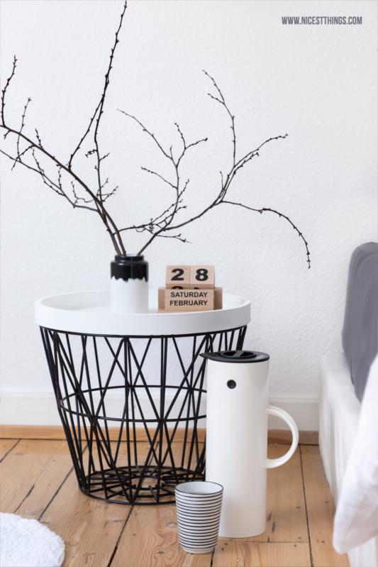Bedside Table: Ferm Living Wire Basket, House Doctor Eternity Calendar,  Stelton Vacuum Jug