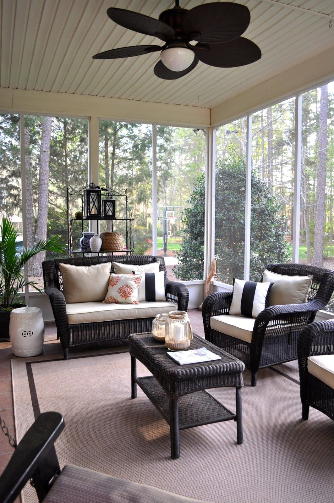 The collected interior home tour screened porch with for Indoor patio decorating ideas
