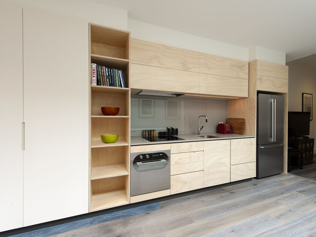 natural timber white mixed with stainless with a black frame highlighting the overhead cabinets constructed. Interior Design Ideas. Home Design Ideas