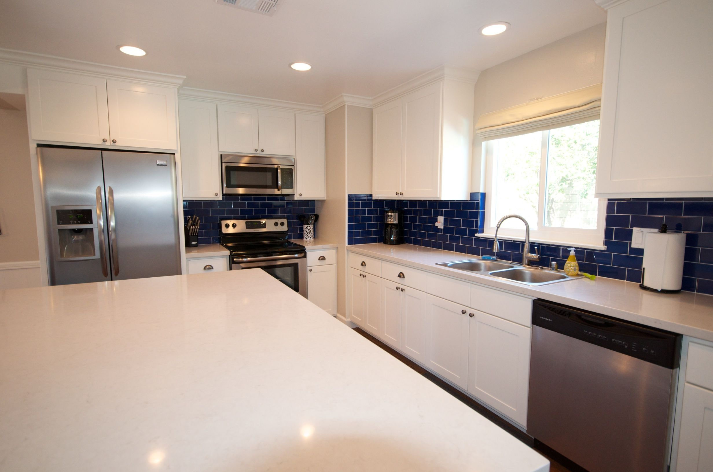 White Cabinets Cobalt Blue Subway Tile From Home Depot London Fog Quartzite Counter Tops