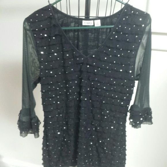 Black top Ruffled black tops with silver flakes.  This is a 3/4 sleeve.  Chiffon type arms...see through only on arms.  Size medium Cato Tops