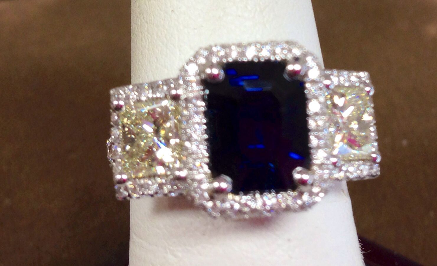 Blue sapphire with yellow diamonds