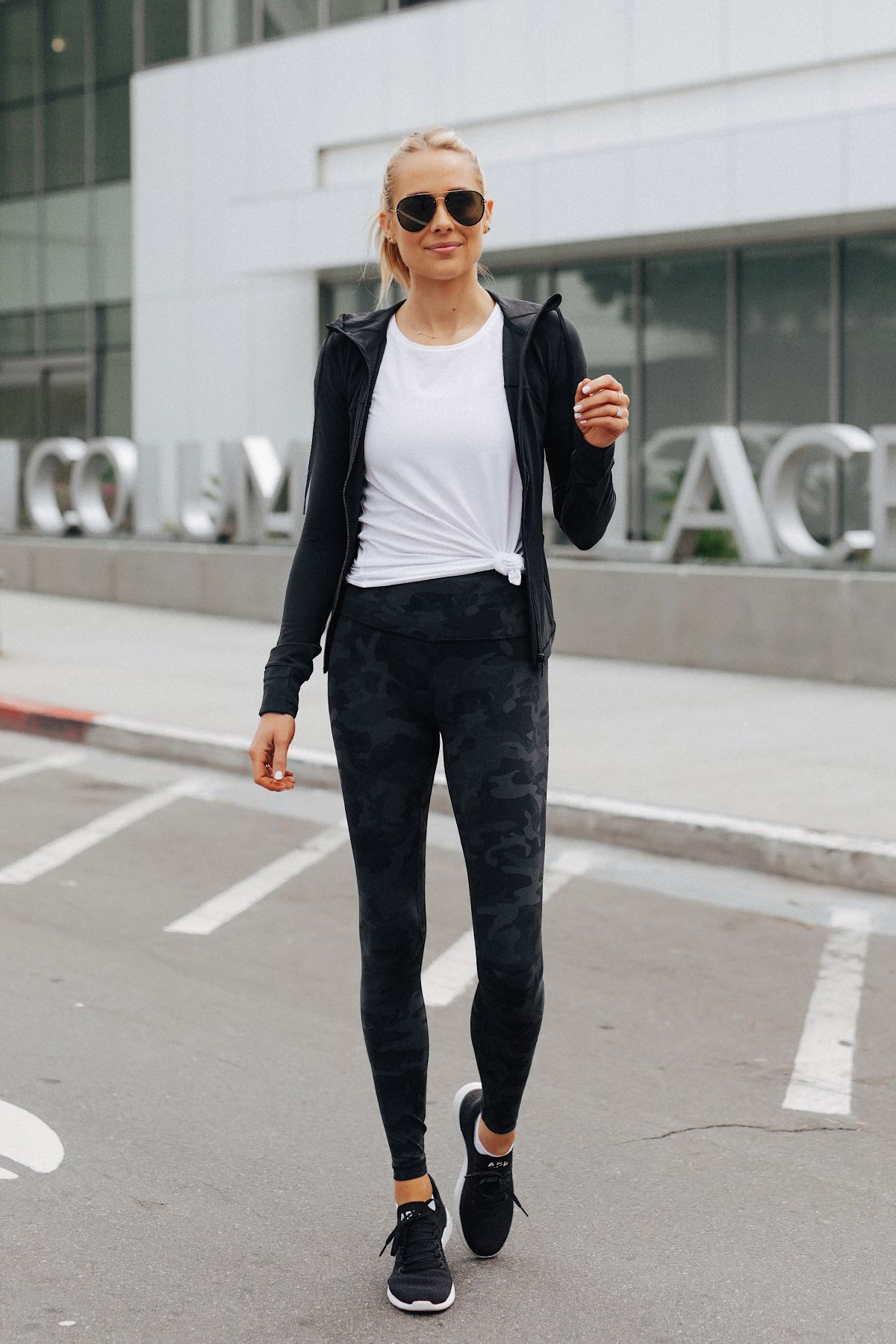 Fashion Jackson Wearing Lululemon Align Pants Black Camo Print White Top Black Jacket Apl Black Snea Athleisure Outfits Outfits With Leggings Lululemon Outfits