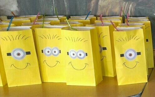 Minion party favors- simple yellow paper bags, you glue on some cutout minion goggles and sharpie in the details