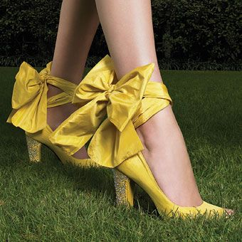 LISTEN... I might need these in my life. Seriously.    Unique Wedding Accessories    Yellow satin peep-toe pumps with taffeta tie and strass heels, $960, by Sonia Rykiel.