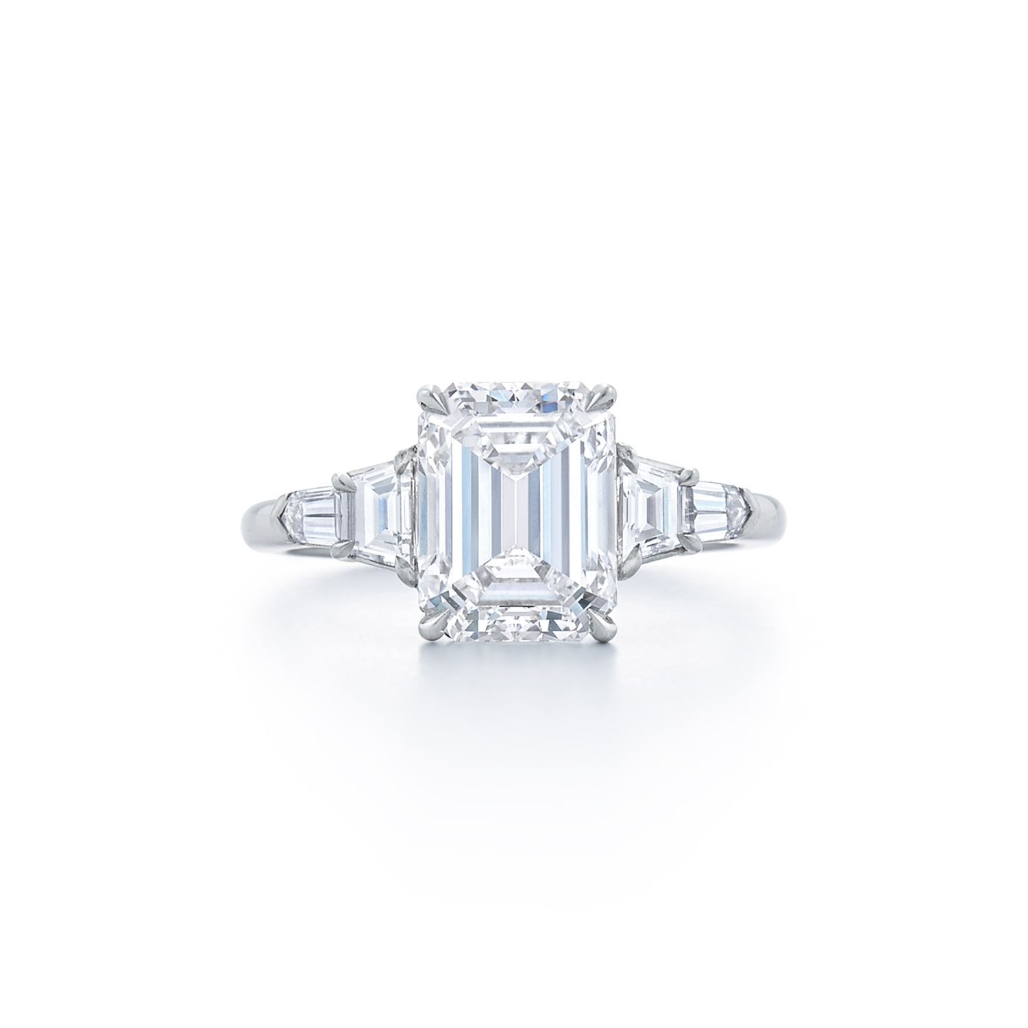 Emerald cut diamond ring with trapezoid and bullet side stones set