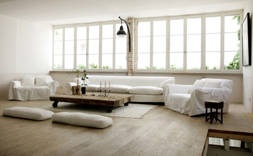 Wood floor and white sofa.