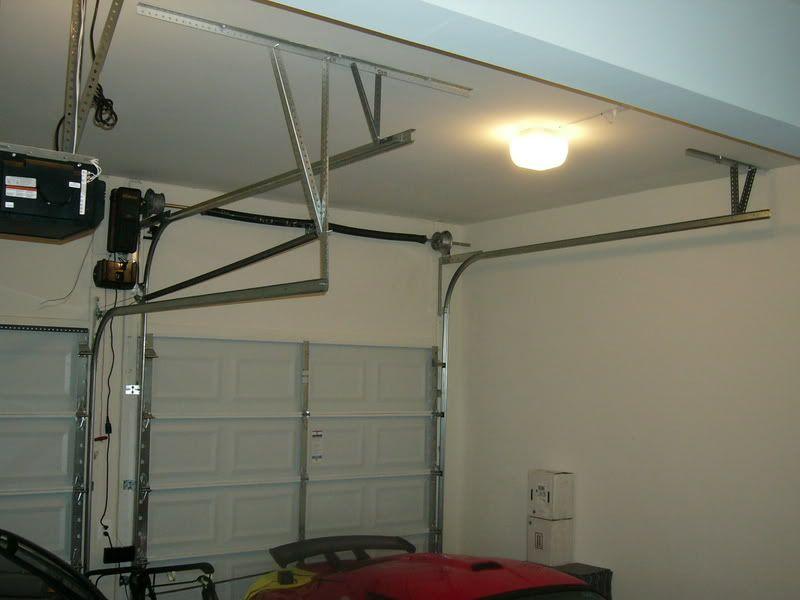 garage door trackImitation wood double track garage door  Brooklyn Garage Door