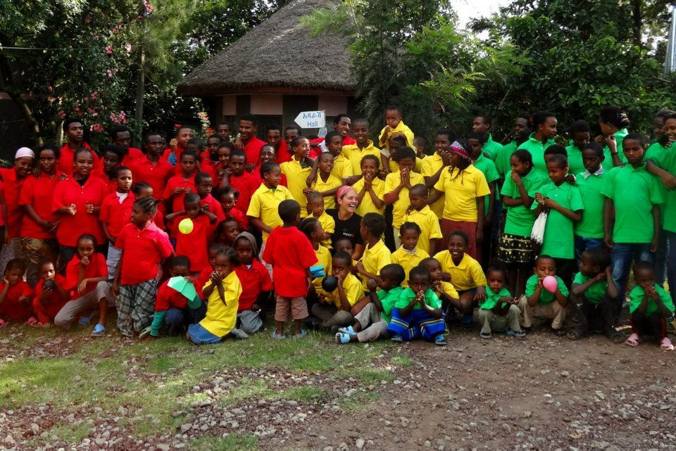 Surrounded by orphans in their new tees at Awassa Children