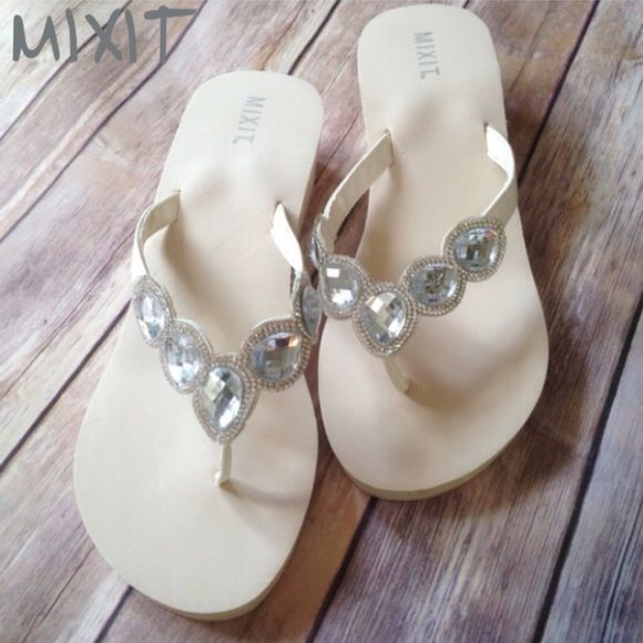 67c3eeb8c0d907 Mixit White Jeweled Thong Sandals Mixit White Jeweled Thong Sandals. Size  10. Check out the BLING on these white foam flip flops