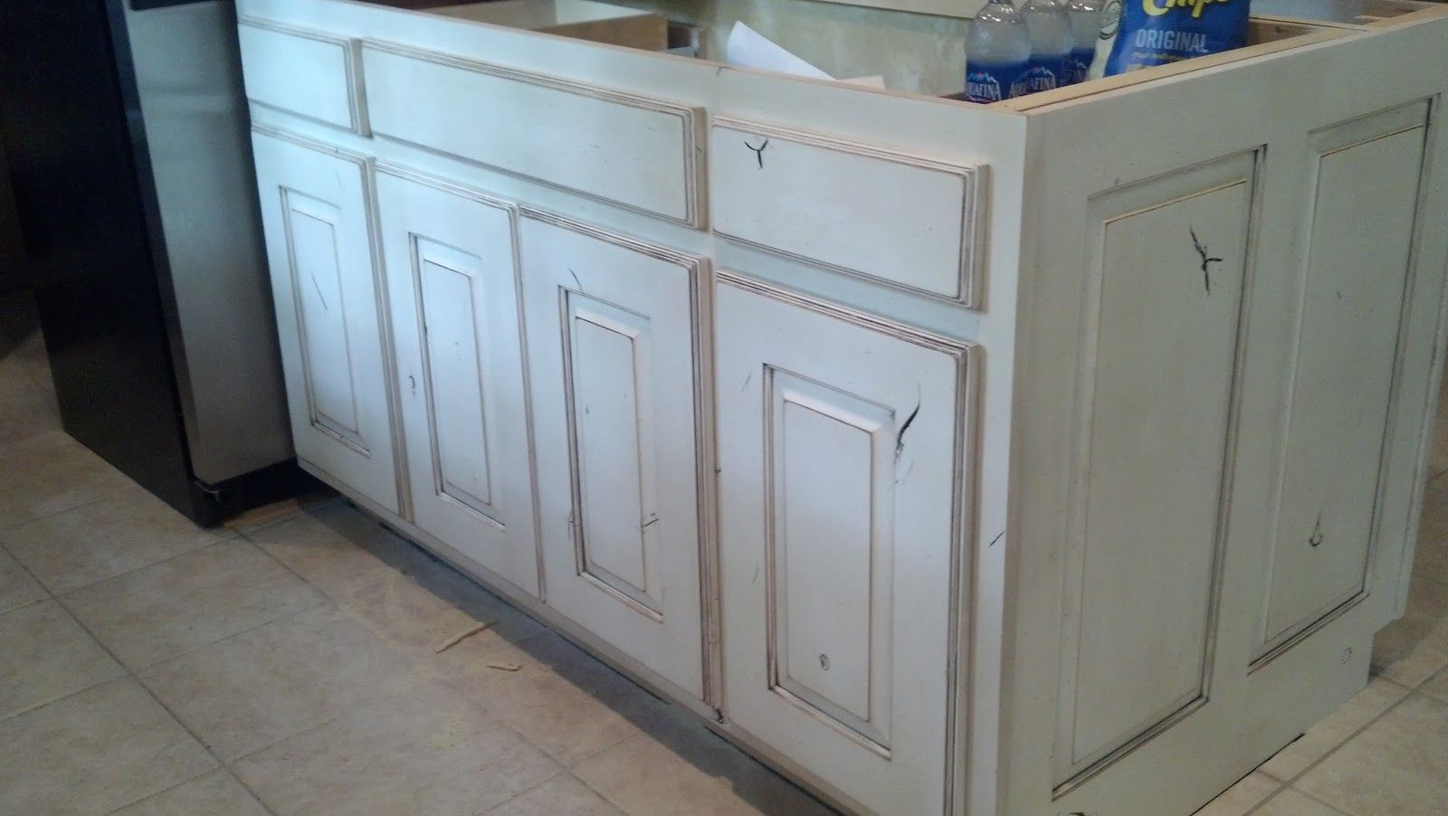 White Painted And Distressed Knotty Alder Cabinets Knotty Alder Cabinets Alder Cabinets Distressed Kitchen Cabinets White