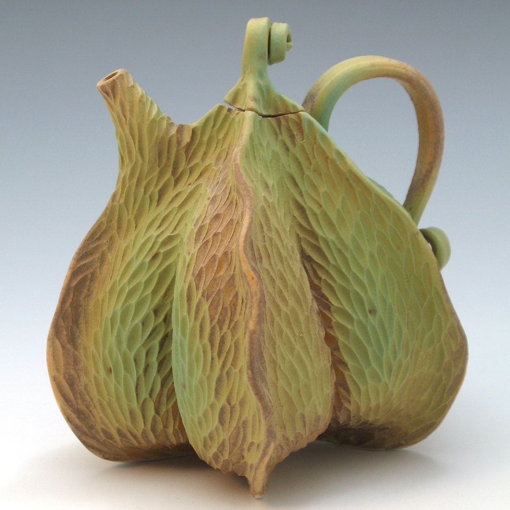 Hand built and carved porcelain teapot green & brown with texture. $175.00, via Etsy.