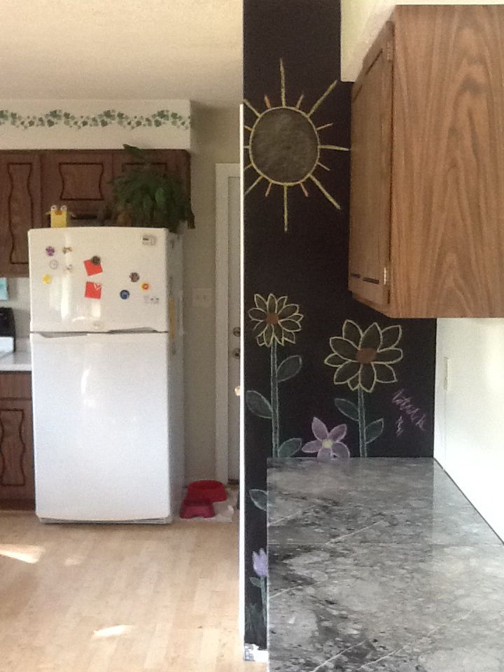 I painted the wall on the side of the pantry with chalkboard paint and Natalie drew a picture. You can also see the marble slabs that we just put in for the desktop.