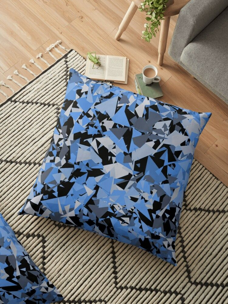 'geometrical cubist blue and grey triangle shapes against black background ' Floor Pillow by IvyArtistic