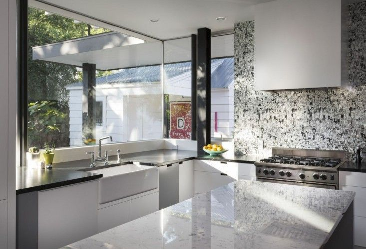 Black And White Modern Kitchen Of Palma Residence In Austin Texas With Soapstone Carrara Marble Countertops