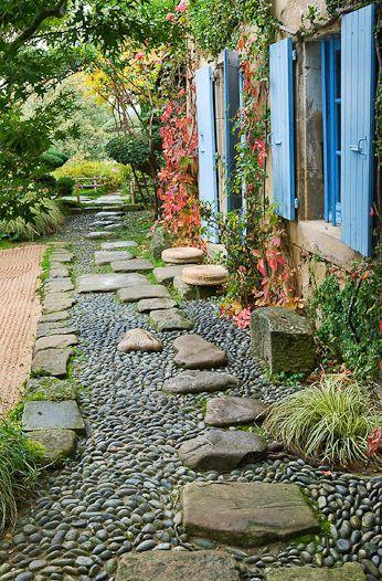 Put Pebbles In Wet Concrete And Set Large Stones Garden