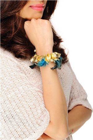 This electrifying bracelet has delicate gold metal shavings accented with pearls peacock blue feathers! So grab this bracelet for INR 464/- from @ShopRhea #trinklets #braceletlove #feather #loveit