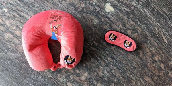 This warm and cuddly neck pillow with matching eye mask can be yours if you are  This warm and cuddly neck pillow with matching eye mask can be yours if you are  This war...