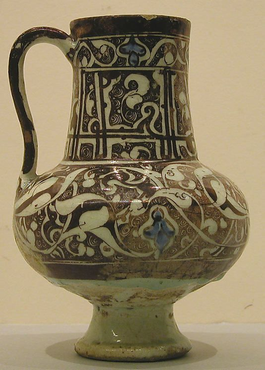 Ewer  Date:late 12th–first half 13th century  Geography:Syria, Raqqa  Culture:Islamic  Medium:Stonepaste; underglaze painted in blue, luster-painted on transparent glaze  Dimensions:H. 7 1/4 in. (18.4 cm) Max. Diam. 5 1/4 in. (13.3 cm)  Classification:Ceramics  Credit Line:Henry G. Leberthon Collection, Gift of Mr. and Mrs. A. Wallace Chauncey, 1957  Accession Number:57.61.1