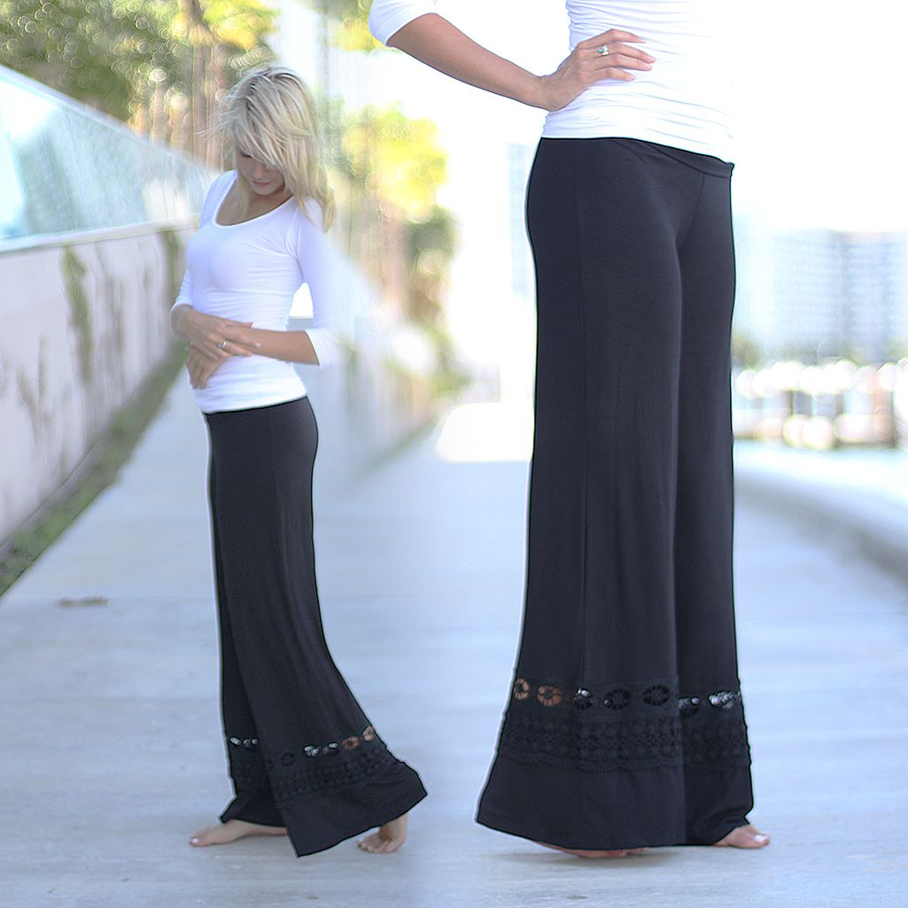 MUST HAVE! Take a look at these amazing Black Palazzo Pants with Crochet Detail! We are so excited about it: they are not only gorgeous but also so comfy! Dress up or down with these amazing pants! The crochet detail is just adorbs! Check out other must have bottoms at our online trendy boutique!
