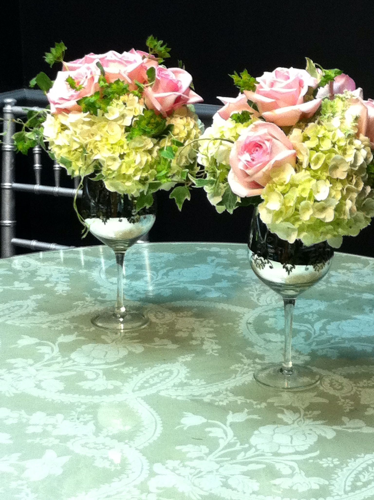 Wine glass wedding flower arrangements a repurposed for Centerpieces made with wine glasses