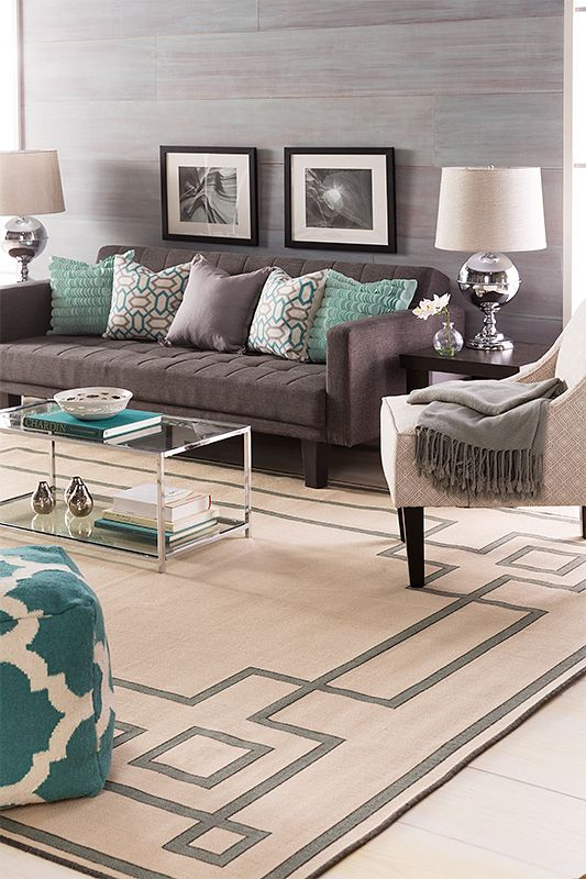 Grays And Teals Work Together To Create A Tranquil Living Room Grounded By An Alfresco Collection Rug Sury Home Living Room Teal Living Rooms Living Room Grey