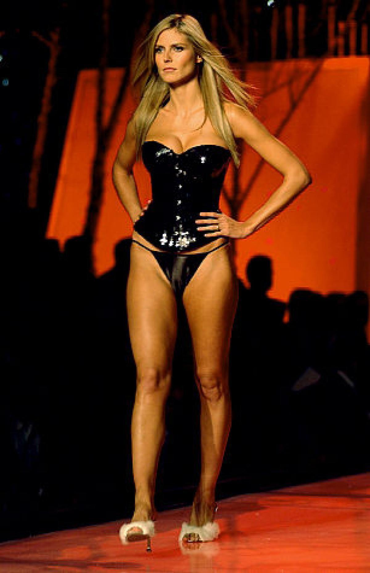 f70547cb03 Klum lights up Bryant Park at the Victoria s Secret Fashion Show in 2001.
