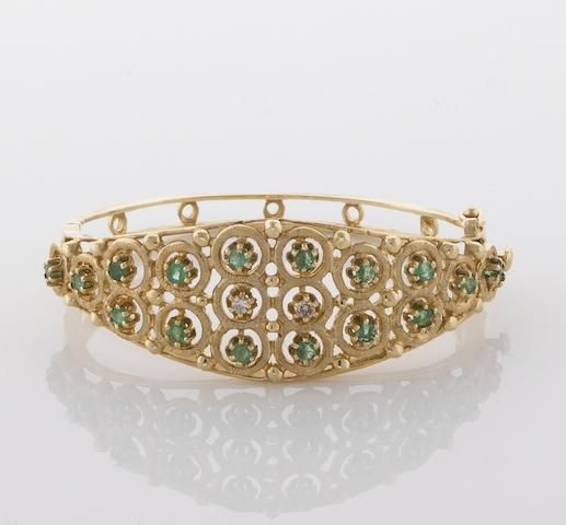 An emerald, diamond and 14k gold bangle bracelet