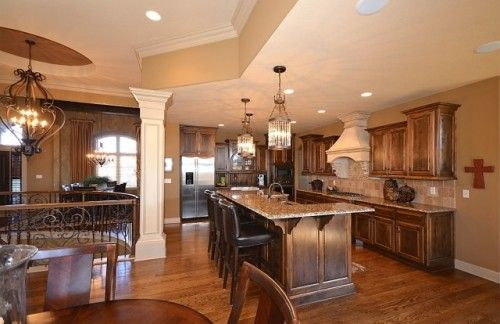 like how the ceiling height separates the kitchen and the ...