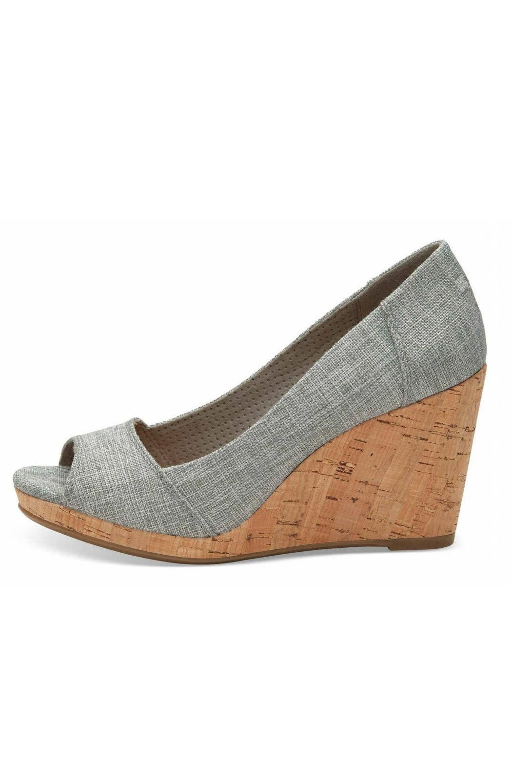 43aab2c0730 The peep toe design and cork heel make this wedge effortlessly stylish.  Wear the Stellas for a park picnic or an evening out. Featuring drizzle grey  lurex ...