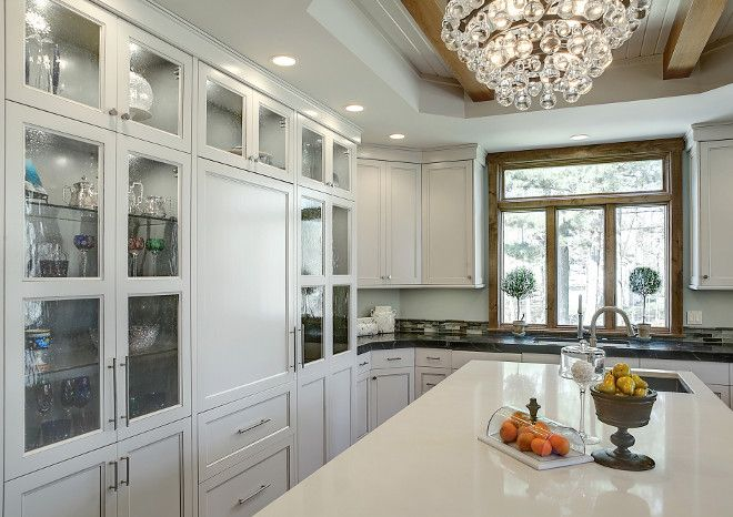 The Perimeter Cabinets Are Painted In A Pale Warm Gray Paint Color - Warm gray cabinets