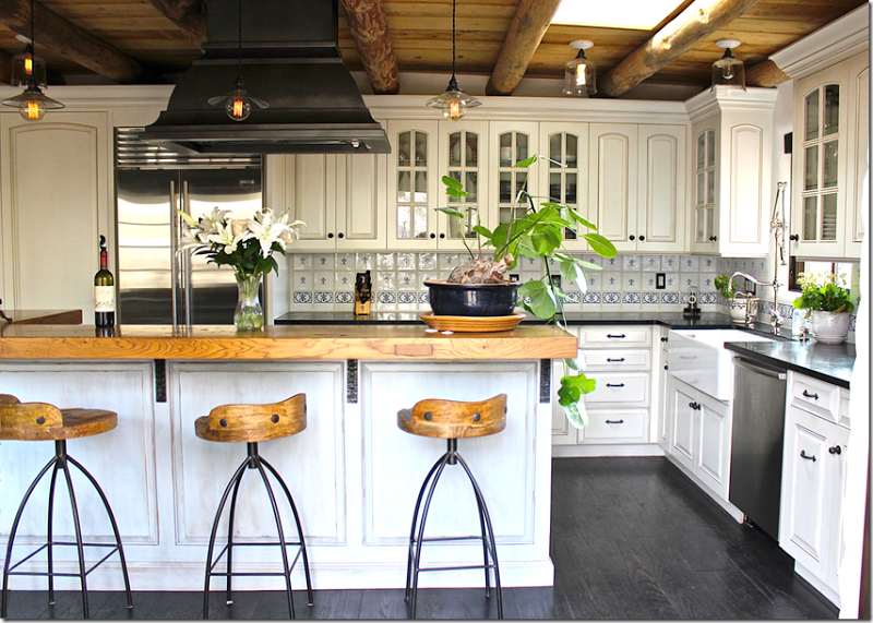 like mixing butcher block with black granite counters