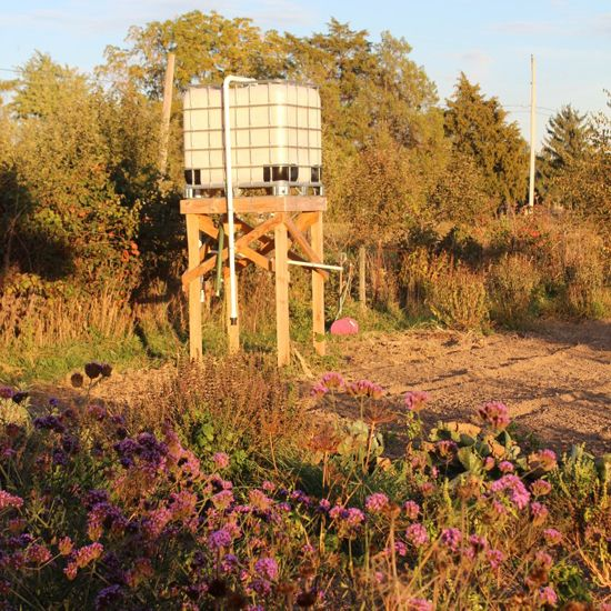 Conserve Water with a rainwater cistern tank and gravity watering system. Read about it in the Homesteading and Livestock Blog from MOTHER EARTH NEWS magazine.