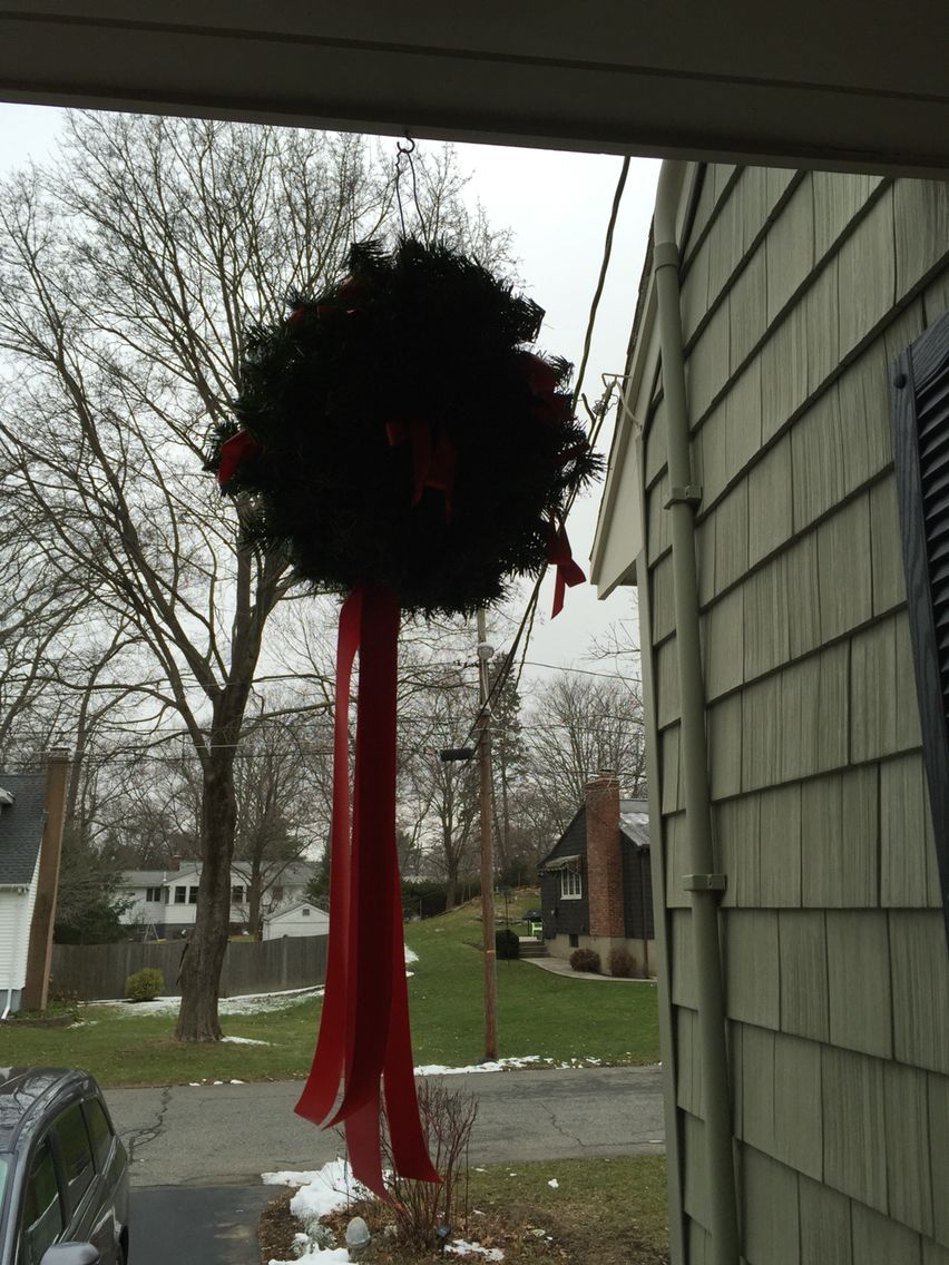 Every year I put up these kissing balls I made for our front porch. It takes a 6 in styrofoam ball, a metal hanger, 2 evergreen ropes, and then decorate! I put heavy red ribbon at bottom. Hang in my basement till next year, look real! Save money!