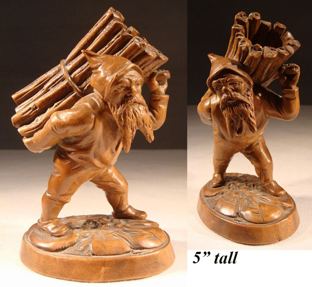 Antique black forest hand carved gnome is a match stand striker