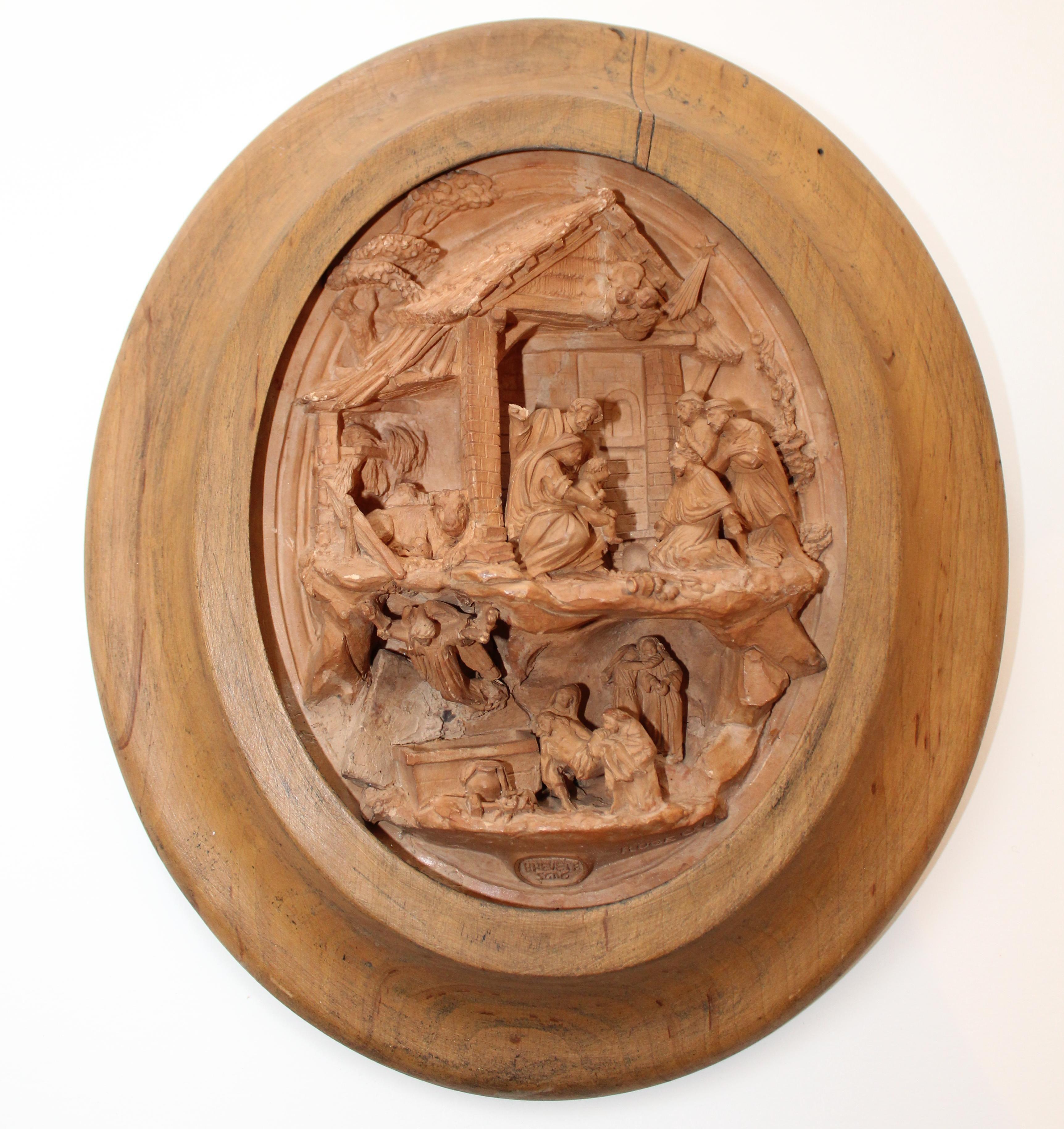Nacimiento de Madera de nogal, barro modelado y cocido/MNAD