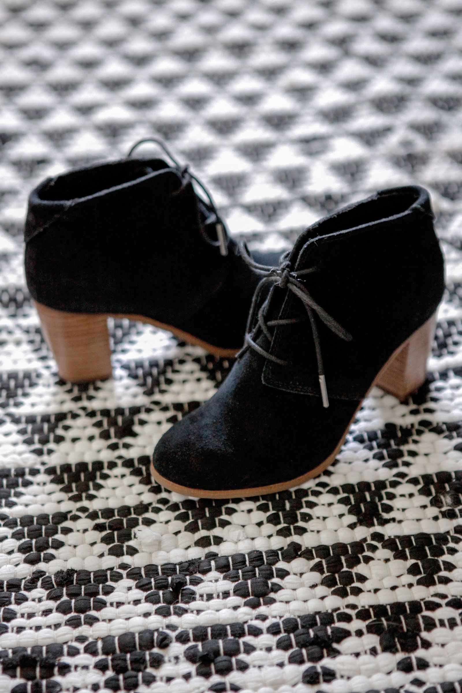 633eb482a1c70d Dress things up with TOMS Lace-up Lunata Booties. These black suede ankle  boots feature a chunky wooden 3 inch heel.