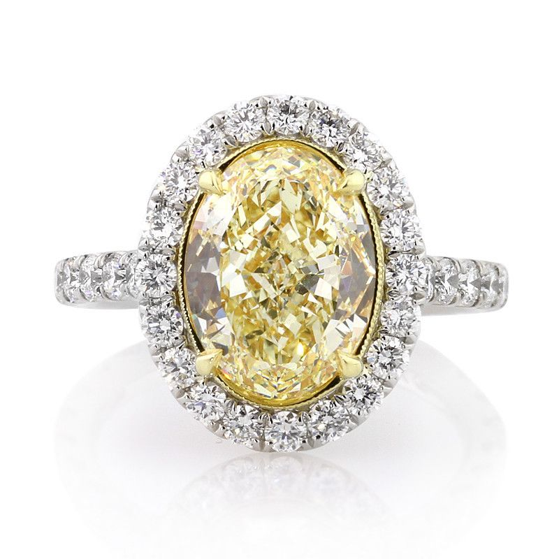 e9eedf0c503 This outstanding fancy yellow oval cut diamond halo ring has great little  details such as diamonds on the connectors. Incredible!   Mark Broumand