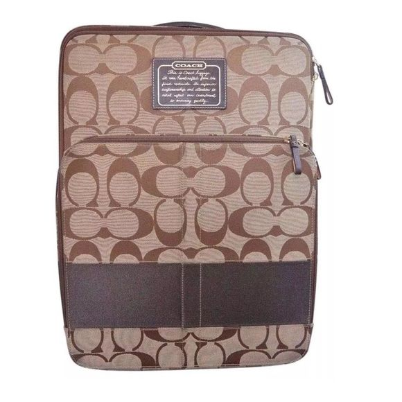 Coach signature print suitcase luggage carry on Canvas Coach signature fabric with dark brown leather detail.   Dark brown stripe around the bag is also canvas  Large zipper compartment on front 2 wheels Zipper compartment on the inside Condition: Overall bag is in good pre-owned condition! Bottom shows fairly heavy signs of wear. Please see all pictures   Inside is very clean.  **100% authentic   Stock #: GB123 Coach Bags Travel Bags