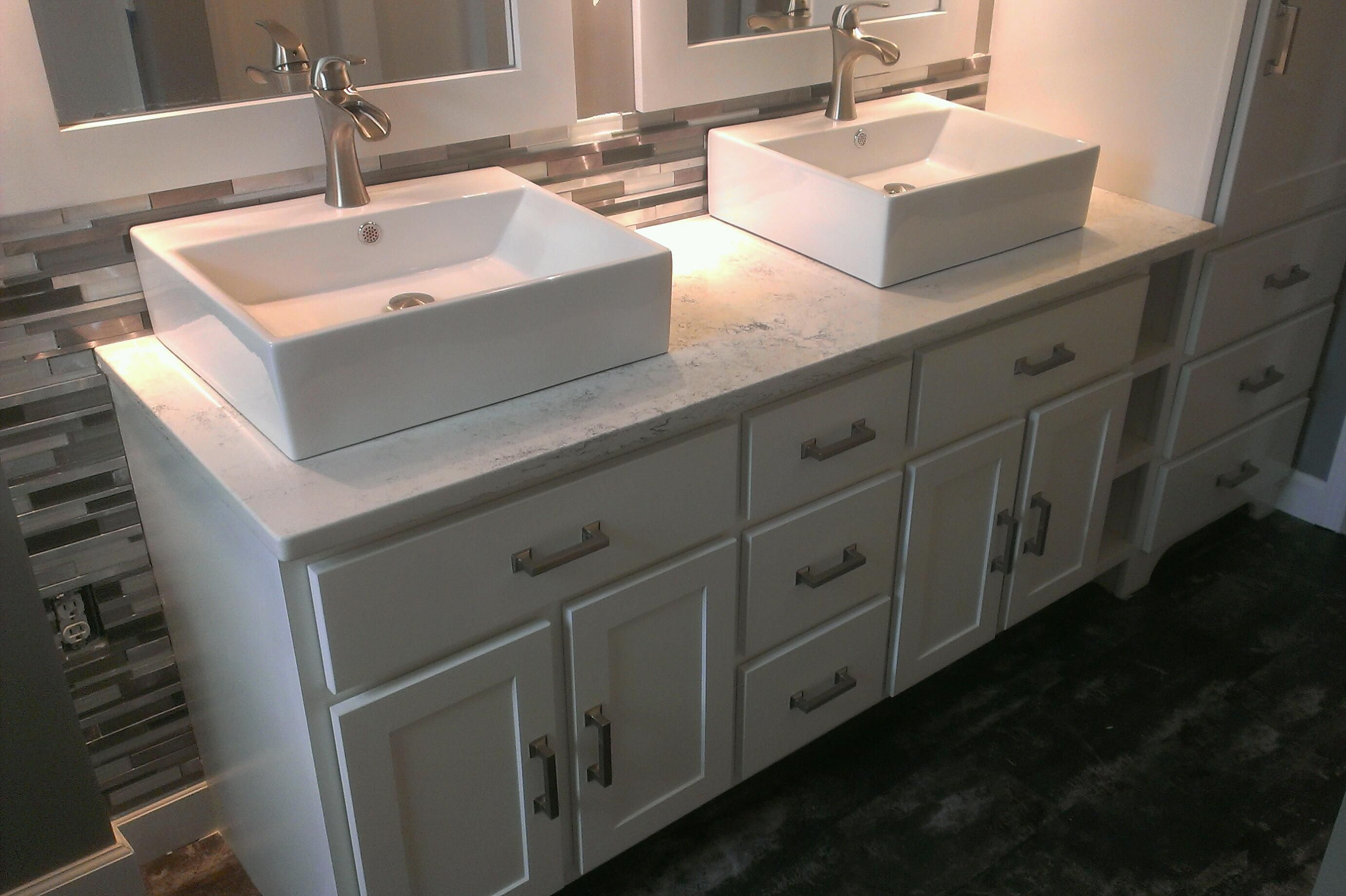 Hickory Hardware Studio Pulls On A Vanity With Raised Double Sinks.
