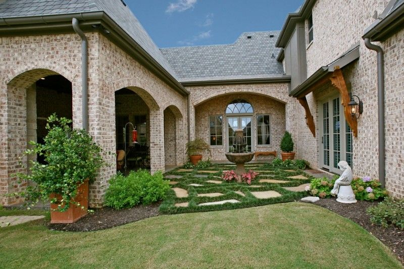 Beautiful Home Gardens With Fountains Brick Walls Wall Lamp Plants Grass Fountain Traditional Landscape Windows Of