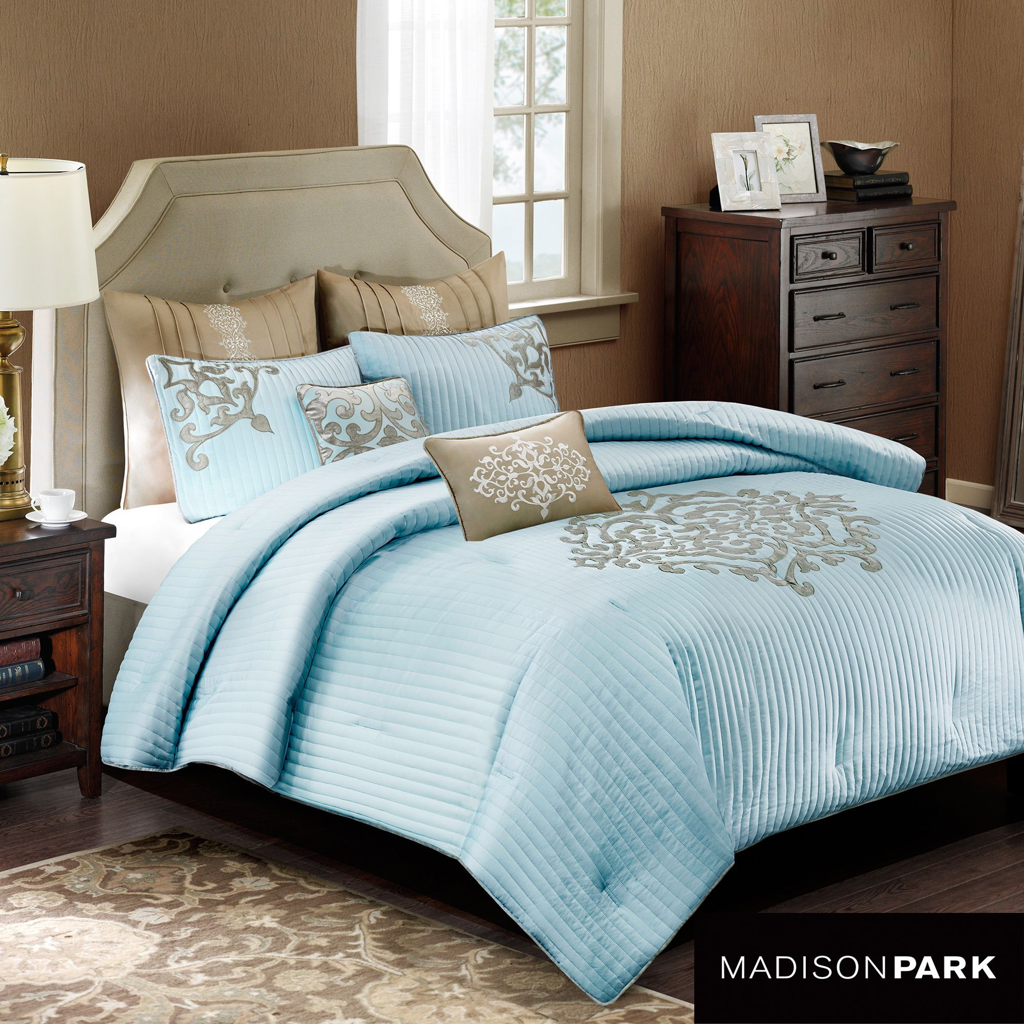 The Bennett comforter adds an elevated look to your bedroom with soft blue vertical stripes to create texture and a large damask print in the middle. A soft gray covers the reverse side of the comforter.