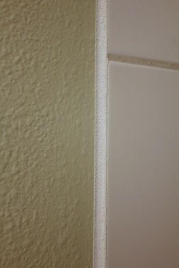 tape 18 inch away from edge of tile caulk edge