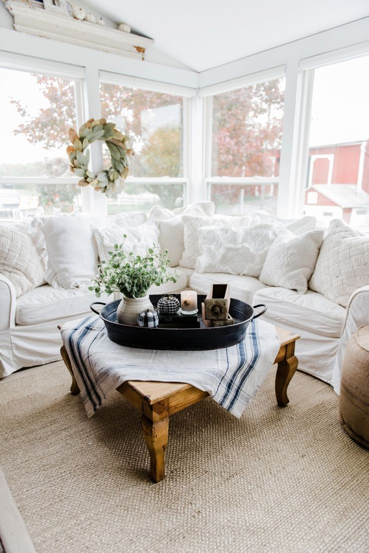 Farmhouse Style Coffee Table In The Sunroom   A Lovely Warm Wood Style  Coffee Table Style With A Tablecloth On Top To Cozy It Up.