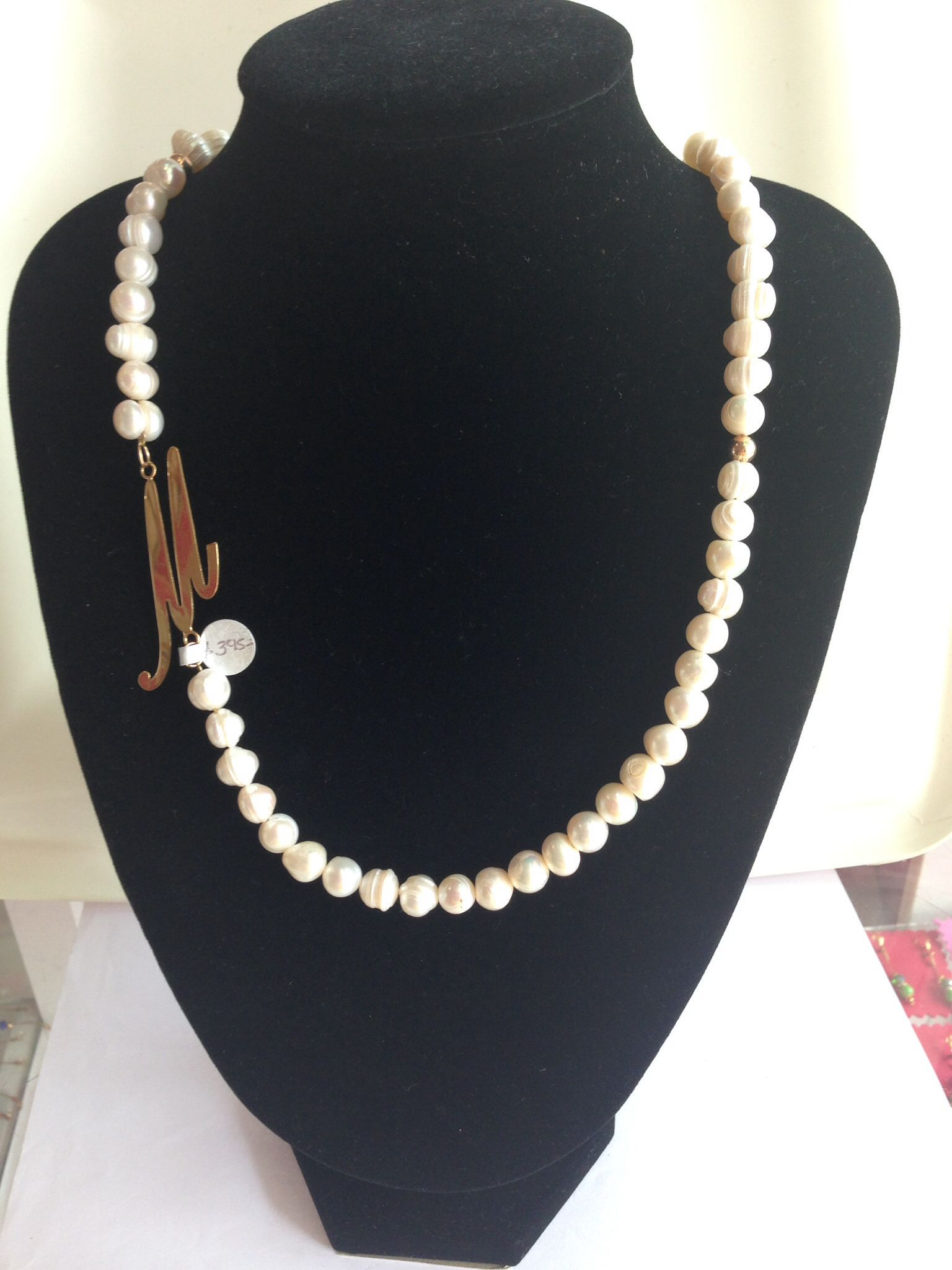 61565d0dfa21 Collar de perla de río con letra M
