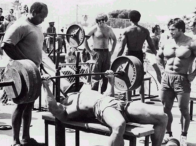Arnold Schwarzenegger On The Bench Press In Venice Beach California With Franco Columbu Watching Best Chest Workout Bench Press Chest Workouts