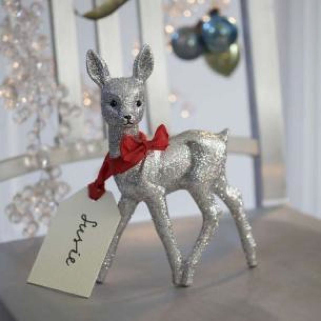 buy cheap deer figurines at dollar store; paint them grey; dip them in glitter; use as place tags! FABULOUS